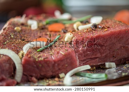 Raw beef meat seasoned and ready to cooked - stock photo