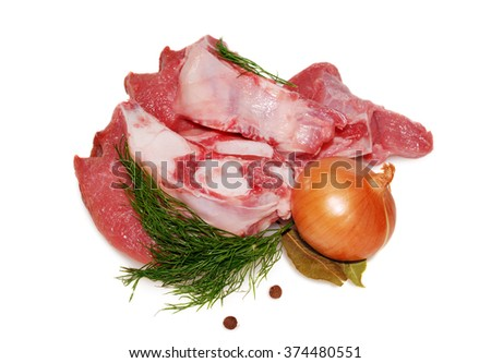 Raw beef meat. Shank steak with fresh vegetables - stock photo