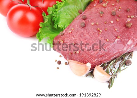 Raw beef meat with vegetables and spices isolated on white - stock photo