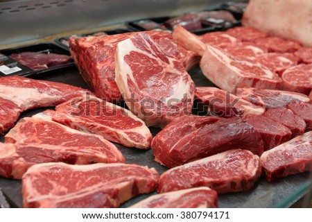 Raw beef on a butcher shop shelf - stock photo