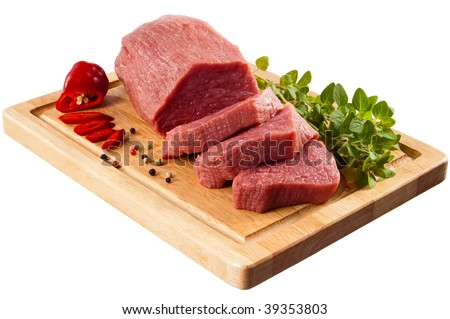 Raw beef on cutting board isolated on white background - stock photo