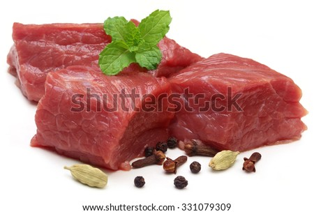 Raw beef Raw beef with spices over white background - stock photo