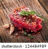 Raw beef steak on a dark wooden table. - stock photo
