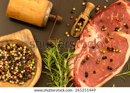 raw beef steak with herbs and spices - stock photo
