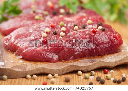 raw beef with spices - stock photo