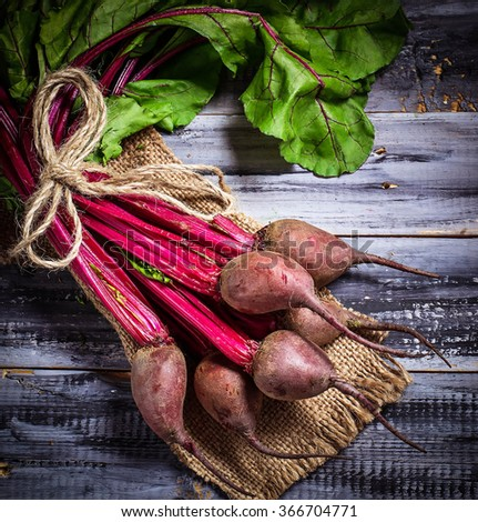 Raw beetroot, square image. Selective focus, toned