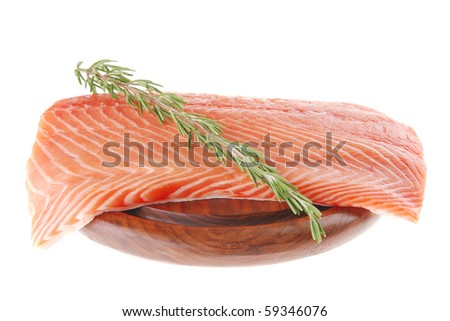 raw big salmon bar on wood plate and rosemary