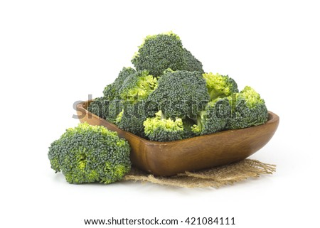 Raw broccoli in a bowl on white background - stock photo