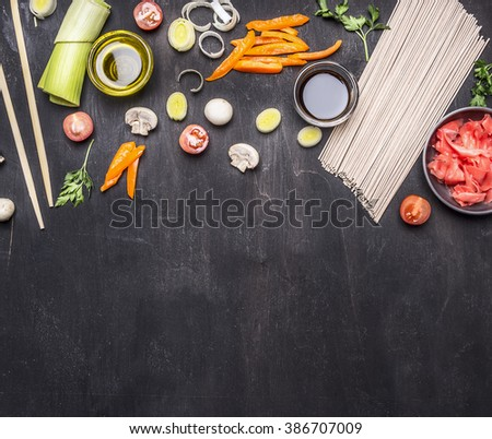 raw buckwheat noodles, pickled ginger, onion, chopped pepper, chopsticks, soy sauce, ingredients for cooking Asian food border ,place for text  on wooden rustic background top view close up - stock photo