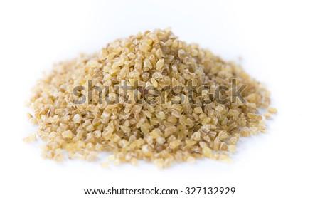 Raw Bulgur (close-up shot) isolated on white background - stock photo