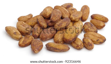 Raw cacao beans isolated on white background