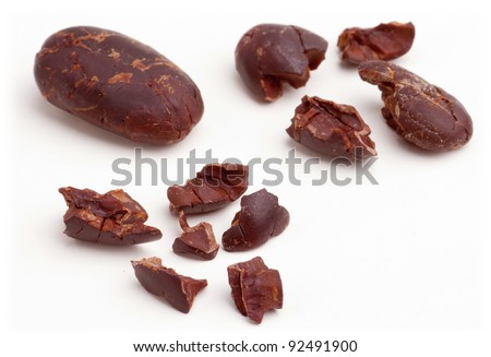 Raw cacao beans peeled isolated on white background. - stock photo