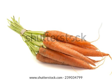 raw carrots on a wooden background - stock photo