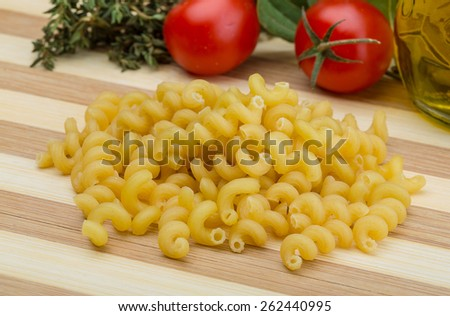 Raw Cellentani pasta on the wood background - stock photo