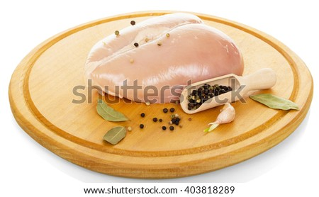 Raw chicken breast and spices isolated on white background. - stock photo