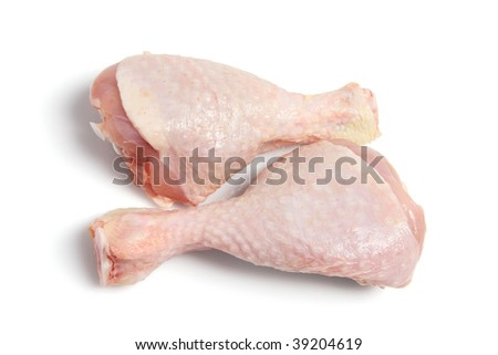Raw Chicken Drumsticks on White Background - stock photo