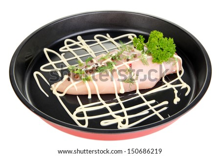 Raw chicken fillets on dripping pan, isolated on white