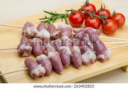 Raw chicken hearts ready for barbecue with rosemary - stock photo