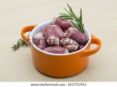 Raw chicken hearts with thyme and rosemary - ready for cooking - stock photo