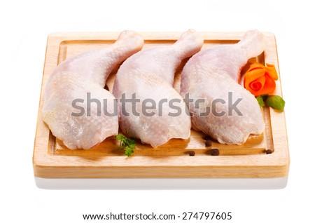 Raw chicken legs on cutting board  - stock photo