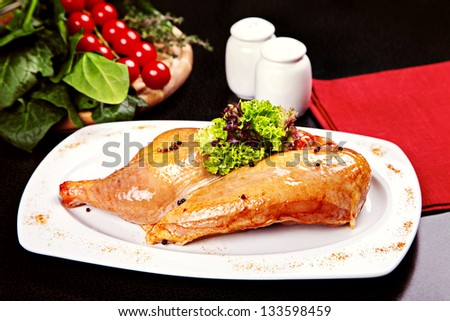 Raw chicken legs served on plate with lettuce and spices - stock photo