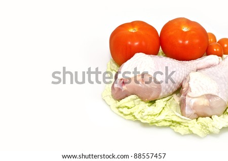 Raw chicken legs with tomatoes
