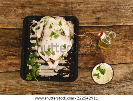 Raw chicken on the table - stock photo