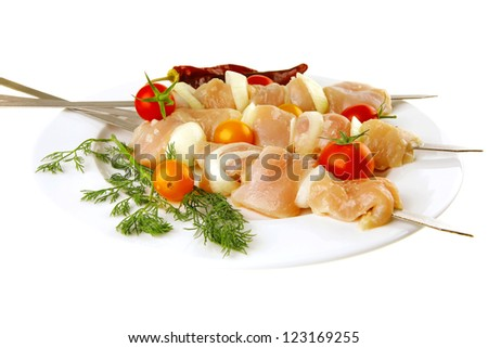 raw chicken shish kebab on white plate - stock photo