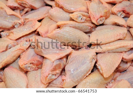 Raw Chicken Wings in supermarket. - stock photo