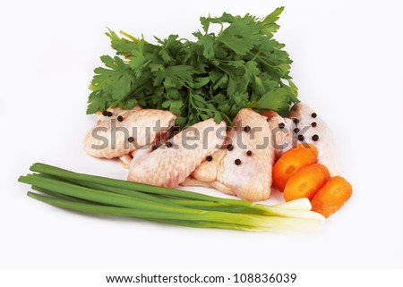 Raw chicken wings with vegetable - stock photo