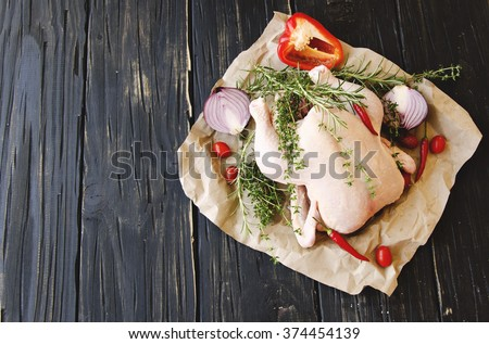 raw chicken with herbs spices ingredients, selective focus - stock photo