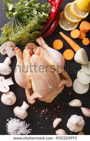 raw chicken with ingredients for cooking broth close-up on the table. vertical view from above - stock photo