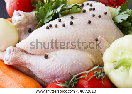 Raw chicken with pepper and vegetables ready to be prepared - stock photo