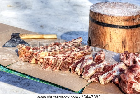 Raw chopped meat ready for sale in local market in winter - stock photo