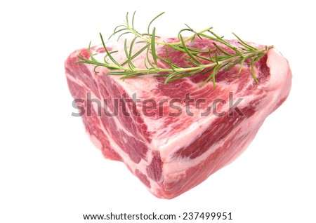 raw chuck steak with rosemary on white background - stock photo