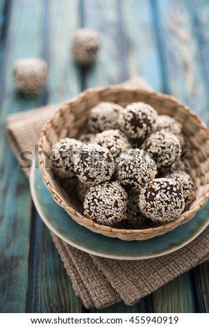 Raw cocoa candies with sesame seeds - stock photo