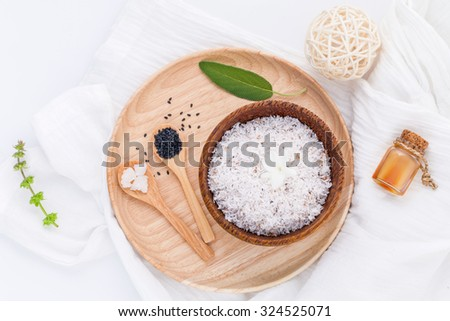 Raw coconut and coconut essential oils  with sea salt and herbs natural spa Ingredients for scrub and skin care isolate on white background. - stock photo
