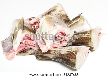 Raw cod fish fillets in kitchen on white background
