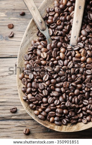 Raw coffee beans on the wooden table, selective focus - stock photo
