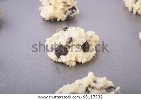 Raw cookie dough on baking sheet. - stock photo