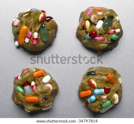 Raw cookie dough with multicolored pills on baking sheet, close-up - stock photo
