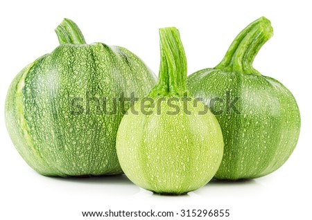 Raw courgettes isolated on white background. Fresh zucchini. - stock photo