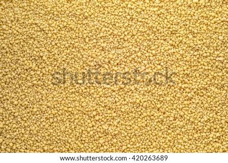 raw couscous background texture closeup - stock photo