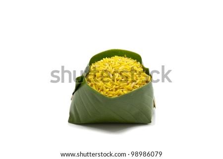 Raw cumin rice on  white background - stock photo