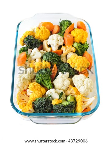 Raw cut vegetables in glass roasting pan - stock photo