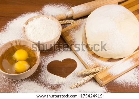 Raw dough on wood background - stock photo