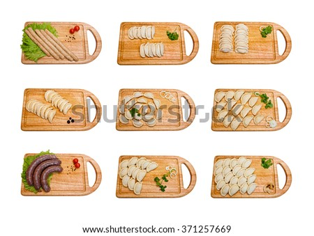 Raw dumplings and sausages on wooden planks isolated on white background. A set of 9 photos - stock photo