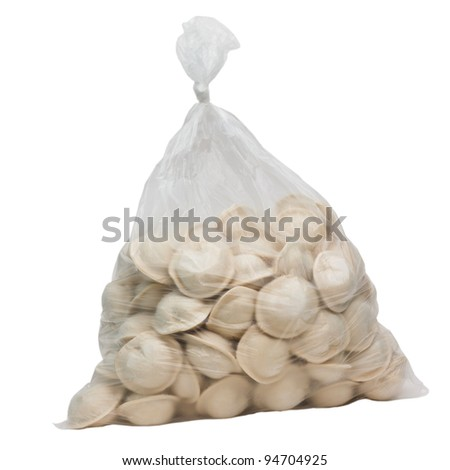raw dumplings in a plastic cellophane bag isolated on white background - stock photo