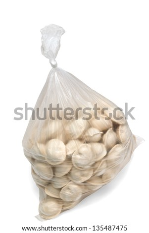raw dumplings in a plastic cellophane bag isolated on white background clipping path - stock photo
