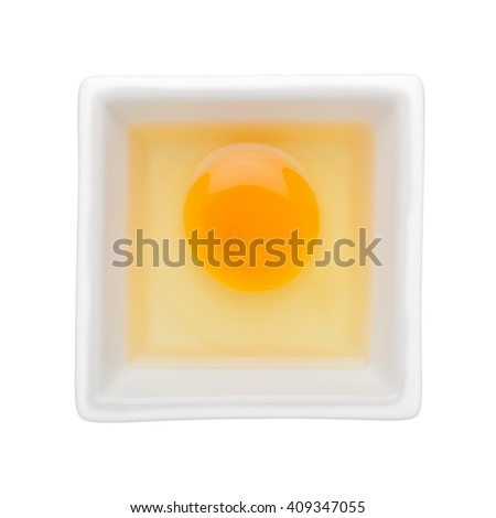 Raw egg in a square bowl isolated on white background
